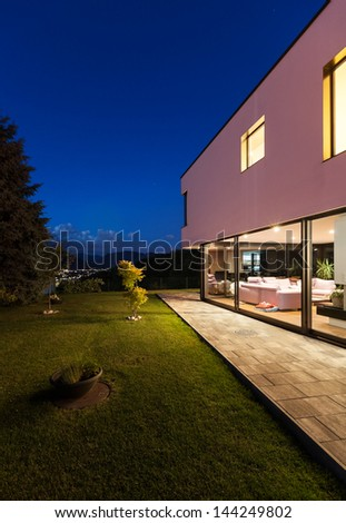 Modern villa with garden, night scene