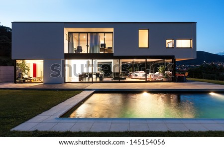 Modern villa with pool, night scene - stock photo