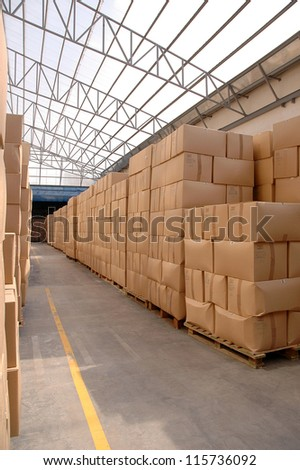 Modern warehouse with cardboard cartons ready to ship - stock photo