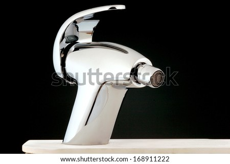 Modern water-supply faucet mixer for water - stock photo