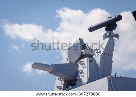 Modern weapons on the deck of a military ship. Weapon system for defense
