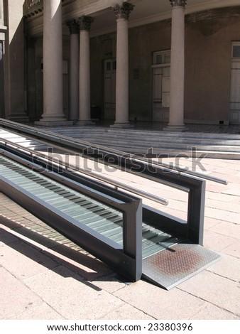 Modern wheelchair ramp in theater door - stock photo