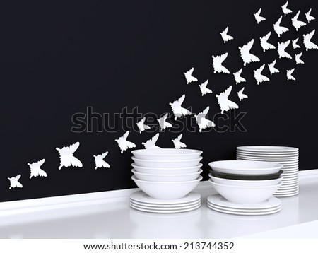Modern white and black kitchen design. Ceramic kitchenware on the shelf. Butterfly decor on the wall. - stock photo
