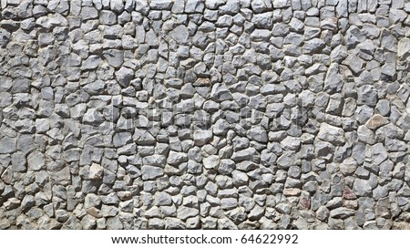 modern white Brick Wall made of fragment stones in irregular shapes - stock photo