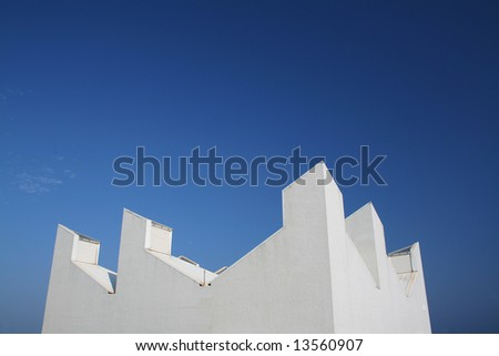 modern  white building with a clean blue sky background - stock photo