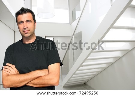 Modern white house lobby medium age man portrait stairway [Photo Illustration] - stock photo