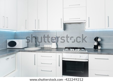 modern white kitchen in minimalism style, frontal view