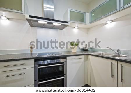 modern white kitchen with decorative elements - stock photo