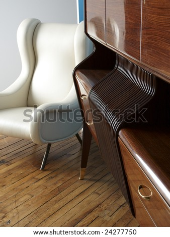 Modern white leather chair and wooden sideboard. - stock photo