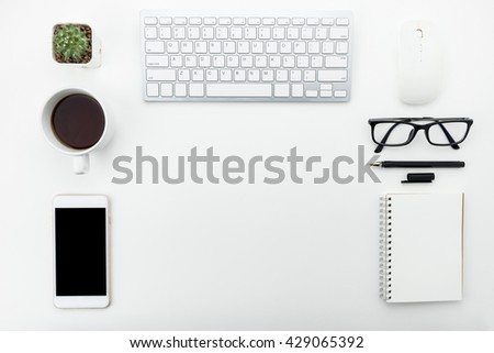 Modern white office desk with supplies put in order. Top view with copy space. - stock photo