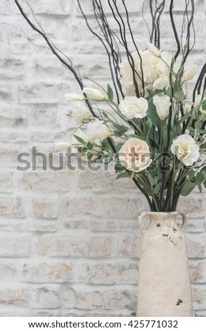 modern white rose decoration on brilck background with copy space for montage your text. - stock photo