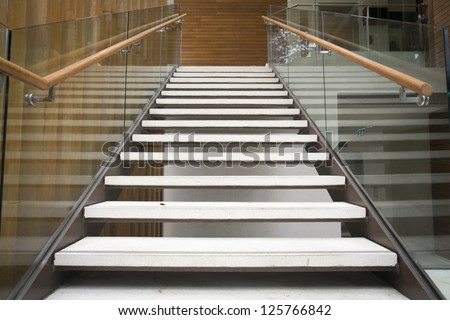 Modern white stairs with wooden handrail - stock photo