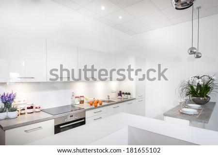 Modern, white stylish kitchen interior design - stock photo