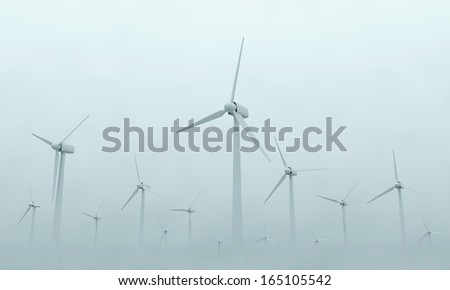 Modern Wind Turbines on Dense Fog. (Animation for this image see in my footage gallery) - stock photo