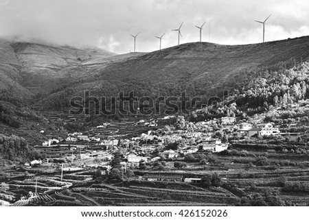 Modern Wind Turbines Producing Energy over the Vineyards in Portugal, Stylized Photo - stock photo