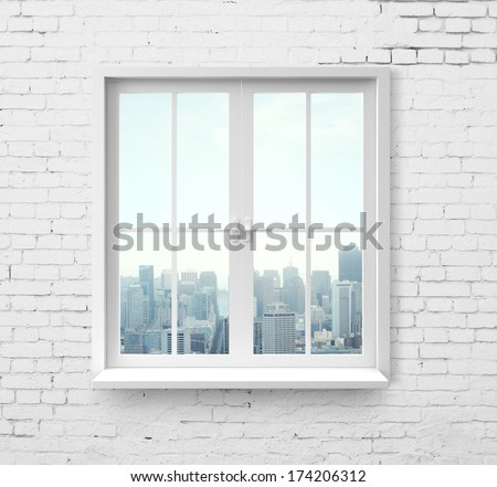 Modern window with skyscraper view in brick wall - stock photo