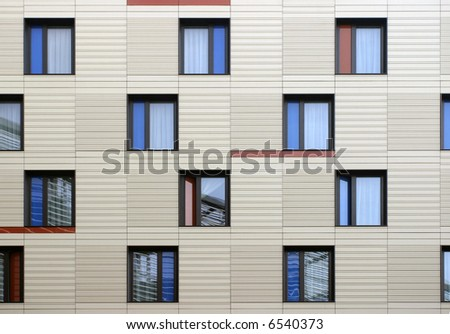 Modern windows mosaic in contemporary modular facade system - stock photo