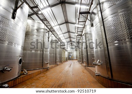modern wine factory with large tanks - stock photo