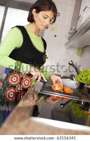 modern woman preparing some healthy food at her kitchen (selective focus with shallow DOF) - stock photo