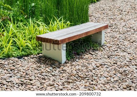 Modern wooden bench in the garden, Thailand - stock photo