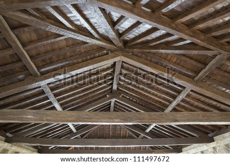 Modern wooden roof with main beam and joist - stock photo