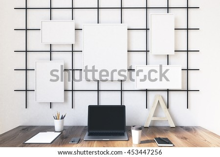 Modern working place with coumputer and various posters on wall. Concept of work and study. 3D render. Mock up. - stock photo