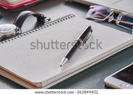 modern working table top view close up of businessman or designer or architect or manager with notebook, glasses, pen, watch, mobile, laptop on leather table with copy space mock up.
