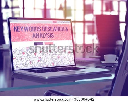 Modern Workplace with Laptop Showing Landing Page in Doodle Design Style with Text Keywords Research and Analysis. Toned Image with Selective Focus. 3D Render. - stock photo