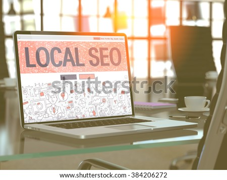 Modern Workplace with Laptop Showing Landing Page in Doodle Design Style with Text Local SEO- Search Engine Optimization. Toned Image with Selective Focus. 3D Render. - stock photo