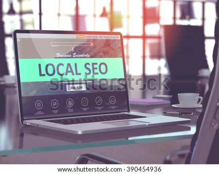 Modern Workplace with Laptop showing Landing Page with Local SEO - Search Engine Optimization - Concept. Toned Image with Selective Focus. 3D Render. - stock photo
