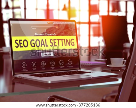 Modern Workplace with Laptop showing Landing Page with SEO - Search Engine Optimization - Goal Setting Concept. Toned Image with Selective Focus. 3D Render. - stock photo