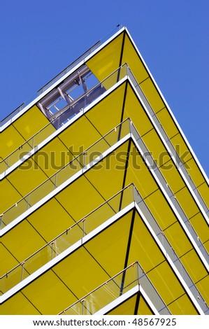 Modern yellow balcony - stock photo