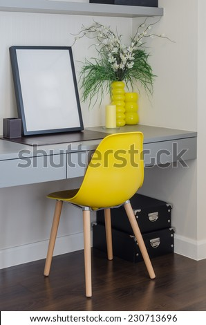 modern yellow chair with grey table - stock photo
