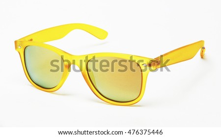 modern yellow sunglasses isolated with shadows