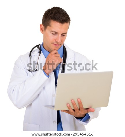 modern young doctor reading email on his laptop - stock photo