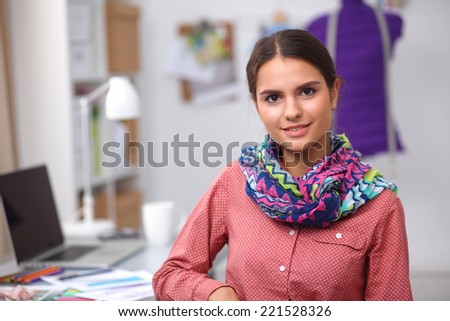 Modern young fashion designer working at studio. - stock photo
