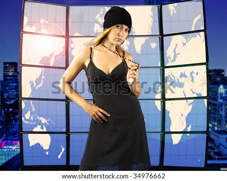 Modern young girl standing in front of earth map on tv screen - stock photo