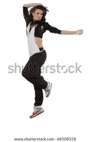 modern young woman dancer in hip hop style jumping over white background and taking position