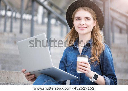 Modern young woman using technologies