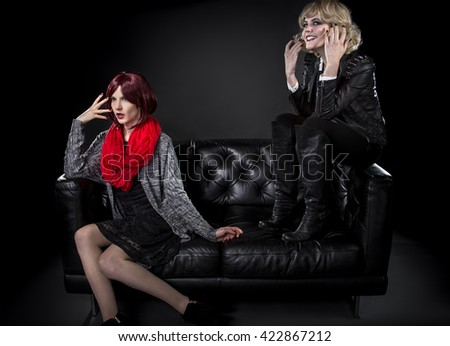 Modest style female annoyed or ashamed of her younger punk fashion sister - stock photo