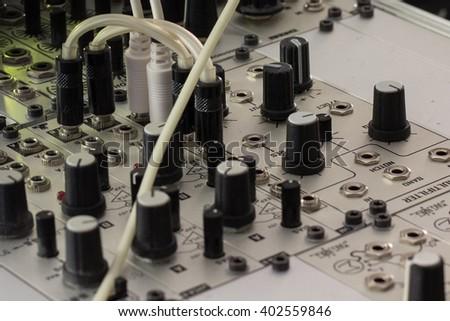 modular synthesizer, analogue synth closeup - music equipment - stock photo