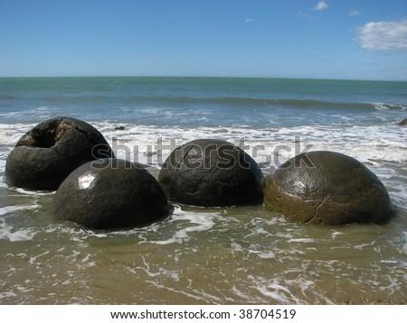 Moeraki Boulders in Otago, South Island. Pacific coast. New Zealand - stock photo