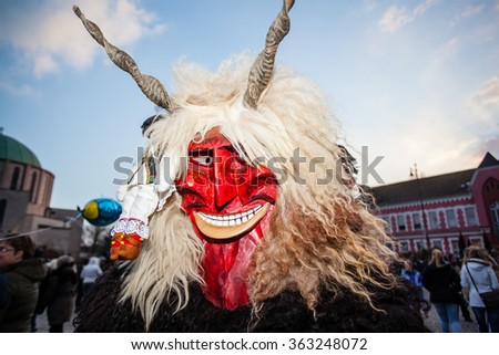 MOHACS, HUNGARY - FEBRUARY 17: Unidentified people in mask participants at the Mohacsi Busojaras, it is a carnival for spring greetings) February 17, 2015 in Mohacs, Hungary. - stock photo