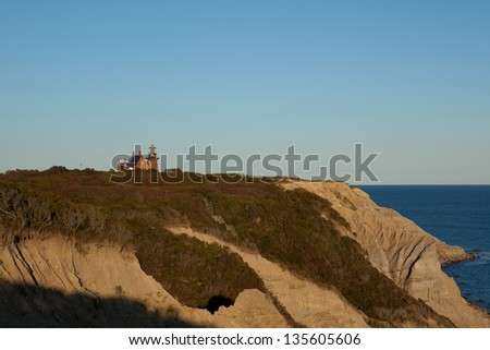 Mohegan Bluffs and the Southeast Lighthouse on Block Island, Rhode Island - stock photo