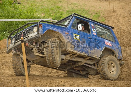 "MOHELNICE, CZECH REPUBLIC - JUNE 10. Unidentified racer at blue off-road car on a steep slope in the ""SHOCK CUP Trial 2012"" on June 10, 2012 in the town of Mohelnice, Czech Republic. - stock photo"