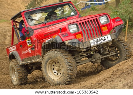 """MOHELNICE, CZECH REPUBLIC - JUNE 10. Unidentified racer at red off-road car in difficult terrain  in the """"SHOCK CUP Trial 2012"""" on June 10, 2012 in the town of Mohelnice, Czech Republic. - stock photo"""