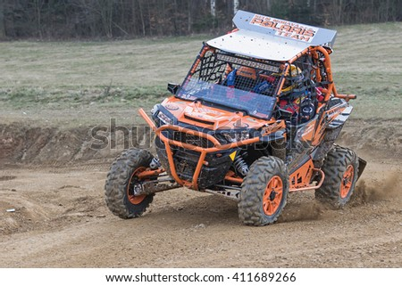"""MOHELNICE,  CZECH REPUBLIC - MARCH 19: Front view of the special orange  off road car is tilted in a curve at """"OffROAD Marathon 2016"""" on March 19, 2016 in Mohelnice, Czech Republic.  - stock photo"""