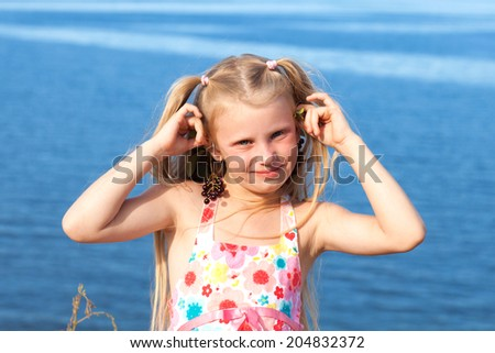 moidel gilrl with chokeberry on the seashore - stock photo