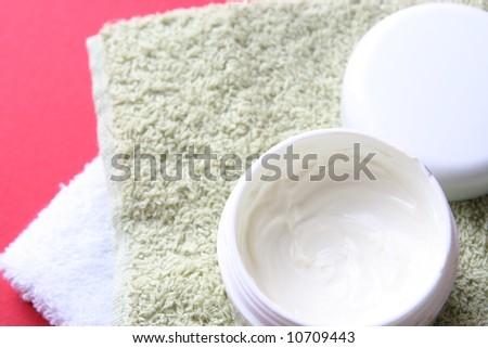 Moisturizing cream isolated on red - stock photo