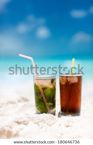Mojito and Cuba Libre on a tropical beach